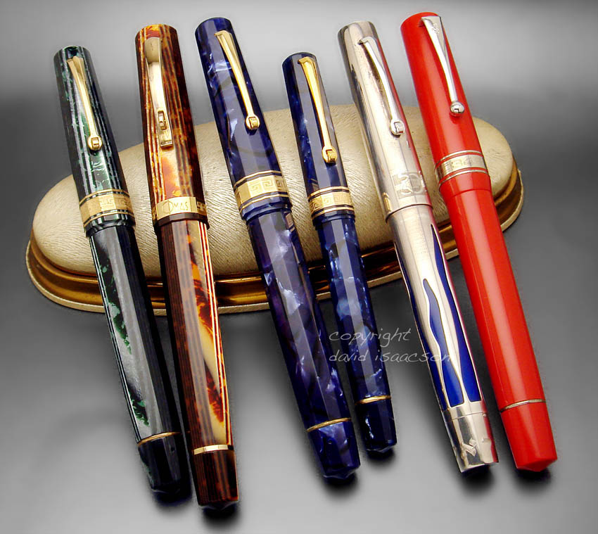 An appearling cluster of classic near-modern/modern Omas pens. 1st Generation Arco-family in green and blue. Recent Arco (brown) Milord.